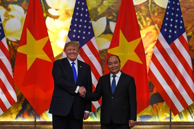 FILE PHOTO: U.S. President Donald Trump shakes hands with Vietnamese Prime Minister Nguyen Xuan Phuc at the Government office, ahead of the second U.S.-North Korea summit, in Hanoi