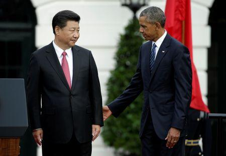 U.S. President Barack Obama stands with Chinese President Xi Jinping during an arrival ceremony at the White House in Washington