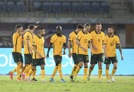 Australia's Jackson Irvine, third right, celebrates with his teammates after scoring his side's second goal during the World Cup 2022 Group B qualifying soccer match between Kuwait and Australia in Kuwait City, Kuwait, Thursday, June 3, 2021. (AP Photo/Jaber Abdulkhaleg)