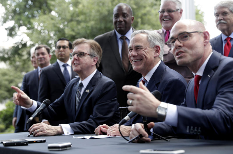 Governor Greg Abbott, seated center, Lt. Governor Dan Patrick, seated left, and Speaker of the House Dennis Bonnen, seated right, and other law makers attend a joint press conference to discuss teacher pay and school finance at the Texas Governor's Mansion in Austin, Texas, Thursday, May 23, 2019, in Austin. (AP Photo/Eric Gay)