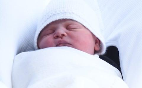 A close-up of the Royal baby's face - Credit: Eddie Mulholland/The Telegraph