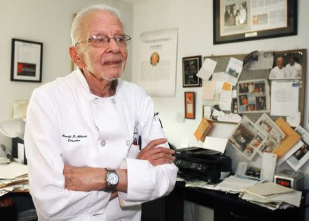 Abbott, president of the Maureen A. Abbott Love Thy Neighbor Fund, Inc., and culinary skills training program, poses in his home in Oakland Park, Florida