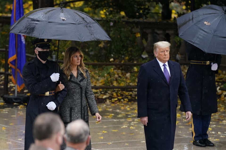 President Donald Trump and first lady Melania Trump observe Veterans Day at Arlington National Cemetery in Arlington, Va., Wednesday, Nov. 11, 2020. (AP Photo/Patrick Semansky)