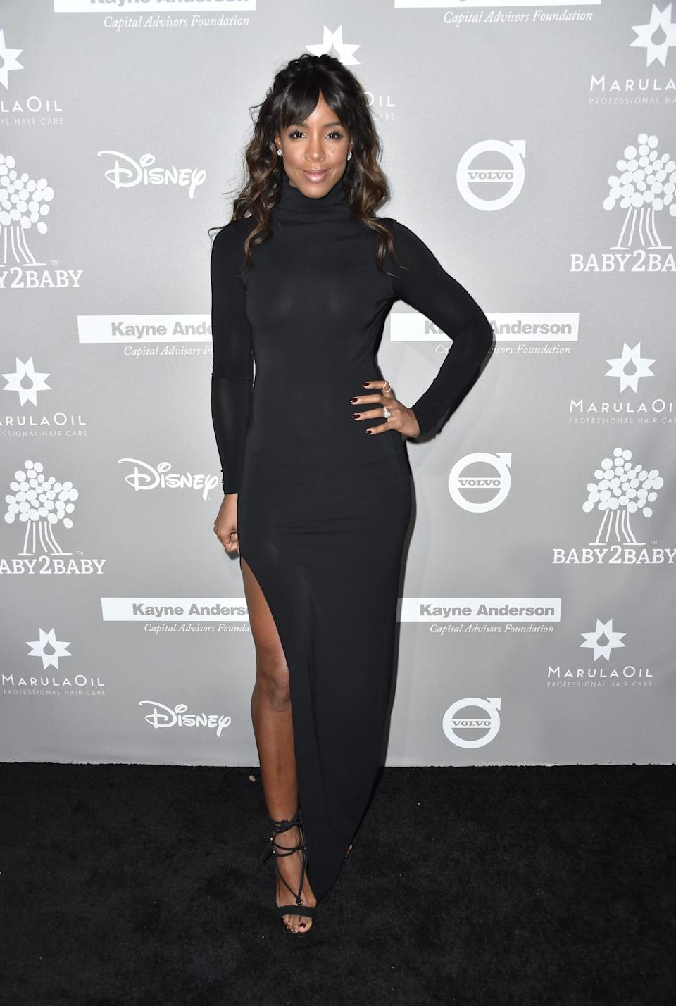 Mum-of-one Kelly Rowland sizzled in a semi-sheer and form-fitting dress. [Photo: Rex]