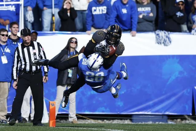 LEXINGTON, KY - NOVEMBER 9: Dorial Green-Beckham #15 of the Missouri Tigers makes a 22-yard touchdown reception in the third quarter against Eric Dixon #28 of the Kentucky Wildcats during the game at Commonwealth Stadium on November 9, 2013 in Lexington, Kentucky. Missouri won 48-17. (Photo by Joe Robbins/Getty Images)