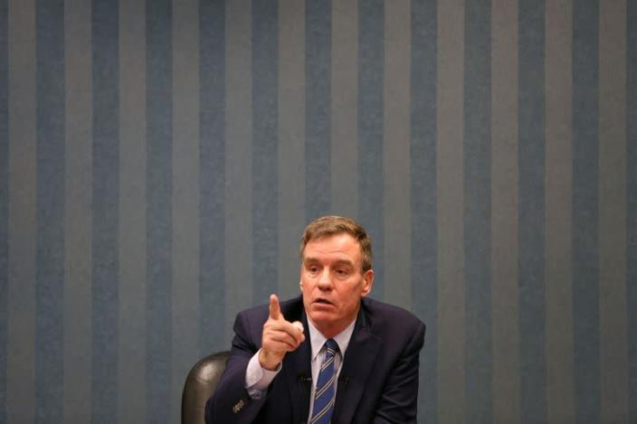 Sen. Mark Warner (D-VA) talks with military families about their hazardous living conditions during a meeting at the Peninsula Workforce Development Office in Newport News