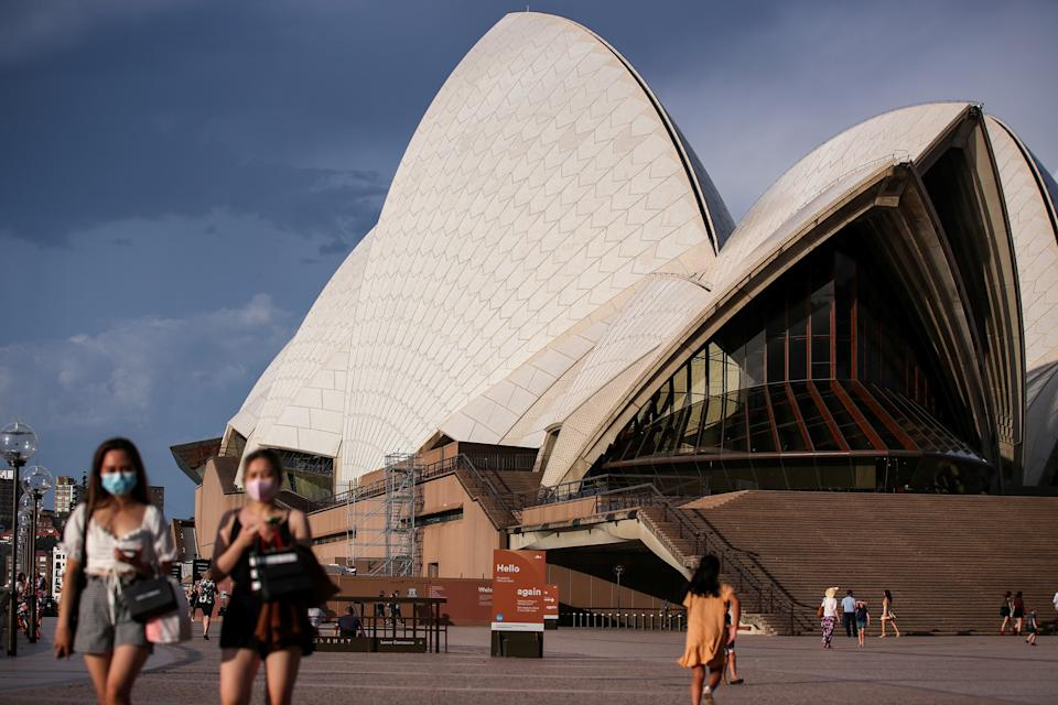 SYDNEY, Jan. 14, 2021 -- People walk past the Sydney Opera House in Sydney, Australia, Jan. 14, 2021. Australia's biggest city of Sydney recorded five locally acquired cases of COVID-19 on Tuesday, as authorities urged the public to get tested and increase openness and transparency with contact tracers. (Photo by Bai Xuefei/Xinhua via Getty) (Xinhua/Bai Xuefei via Getty Images)