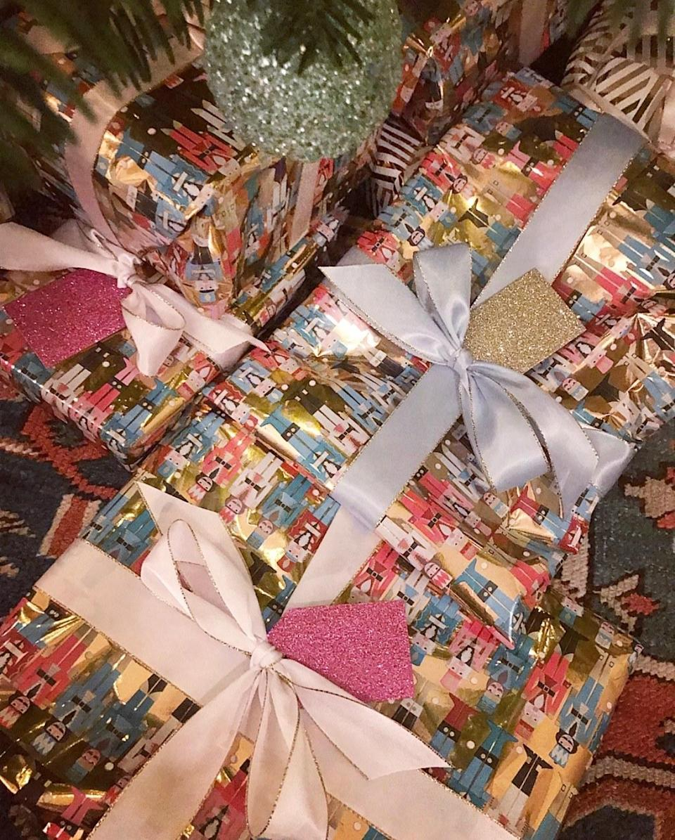 I really love wrapping. This year's was colored nutcrackers, satin bows, and glitter tags.