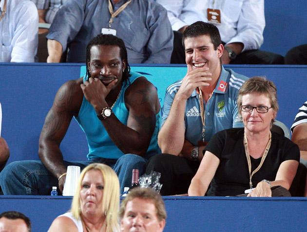 PERTH, AUSTRALIA - JANUARY 04: West Indian cricketer Chris Gayle watches the mens singles match between Novak Djokovic of Serbia and Lleyton Hewitt of Australia on day four of the Hopman Cup on January 4, 2011 in Perth, Australia.  (Photo by Paul Kane/Getty Images) *** Local Caption *** Chris Gayle