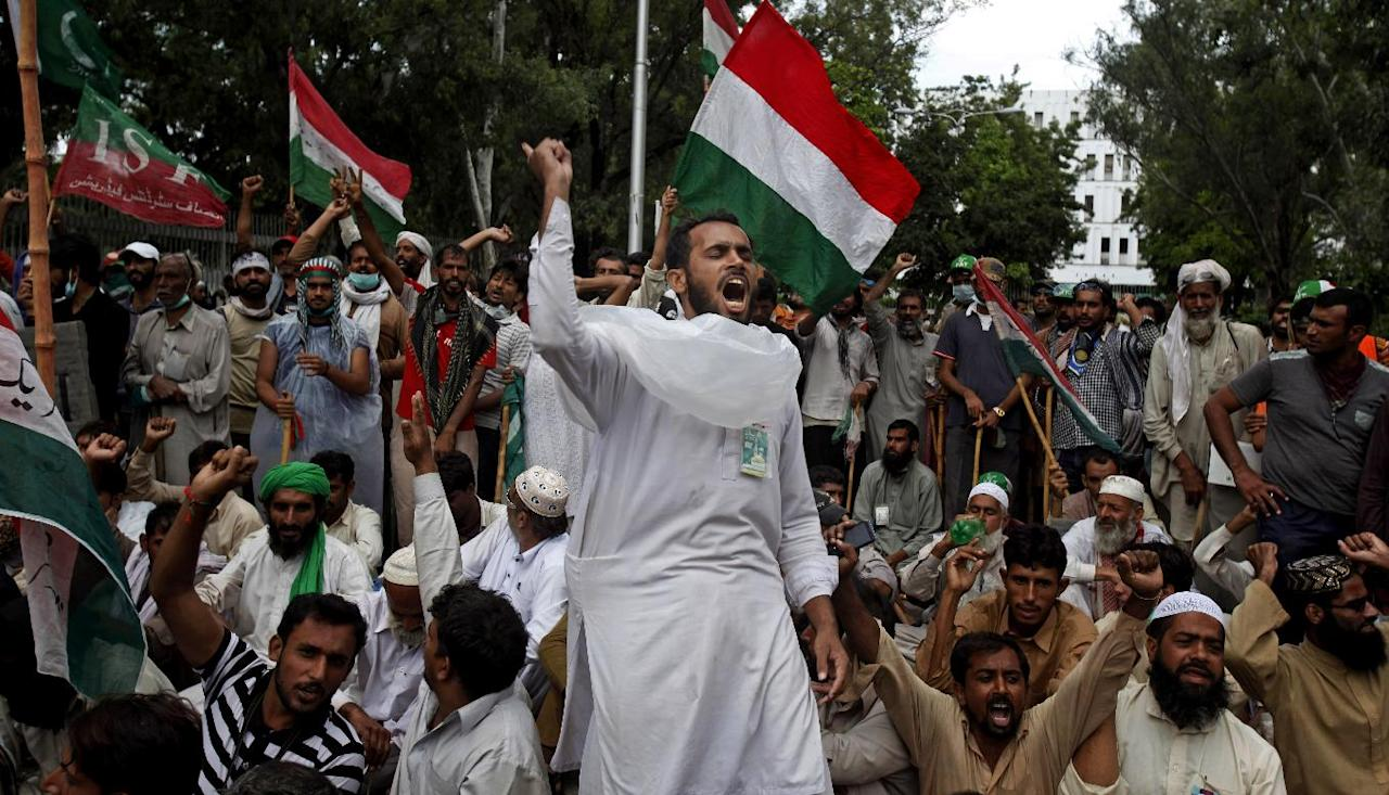 Supporters of anti-government Muslim cleric Tahir-ul-Qadri chant slogans during a protest close to Prime Minister's home in Islamabad, Pakistan on Monday, Sept. 1, 2014. Anti-government protesters and Pakistani police have clashed once again as the demonstrators pushed into a sprawling government complex in the country's capital in an effort to try to reach the prime minister's official residence. (AP Photo/Anjum Naveed)