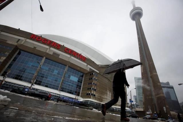 An ice storm forced the Blue Jays to postpone their game with the Royals after ice fell from the CN Tower and ripped a hole in the Rogers Centre roof. (Canadian Press)