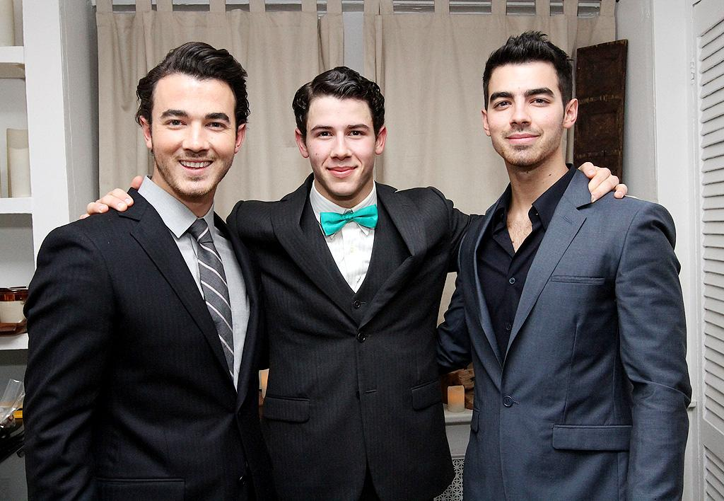 "Kevin and Nick Jonas are so ""fed up"" and ""sick"" of their brother Joe's wild ""partying, random hookups and complete lack of focus,"" reveals <i>Star,</i> that they're going ""to boot him from the group unless he shapes up immediately."" For details about Kevin and Nick's intervention, and how close they are to firing Joe, log on to <a target=""_blank"" href=""http://www.gossipcop.com/joe-jonas-kicked-out-group-nick-kevin-brothers-intervention/"">Gossip Cop</a>."