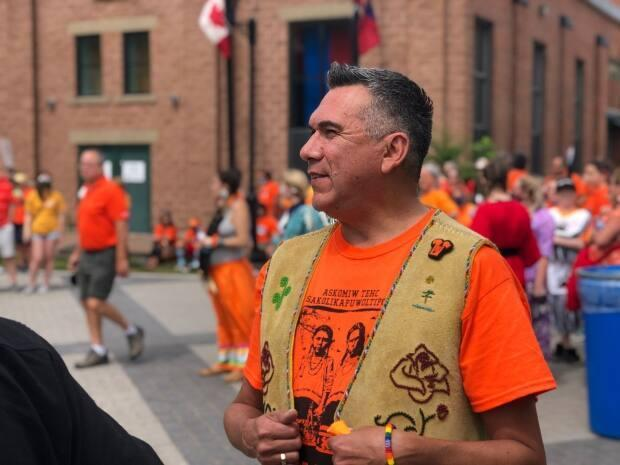 St. Mary's First Nation Chief Allan Polchies Jr., seen here at Resilience Day events in Fredericton on July 1, says the province should be discussing the river's name change with Wolastoqey communities. (Gary Moore/CBC - image credit)