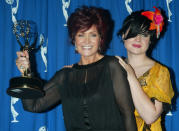 """Sharon Osbourne, producer and wife of rock star Ozzy Osbourne (L) poses with the Emmy award she won for Outstanding Non-Fiction Program (Reality) for MTV's """"The Osbournes"""", at the 2002 Primetime Creative Arts Emmy Awards, September 14, 2002 in Los Angeles, alongside her daughter Kelly. The reality television show features her husband, rock star Ozzy Osbourne, and their family. Sharon Osbourne recently underwent treatment for colon cancer. The Primetime Emmy awards will be presented September 22 in Los Angeles. REUTERS/Fred Prouser FSP/GN"""