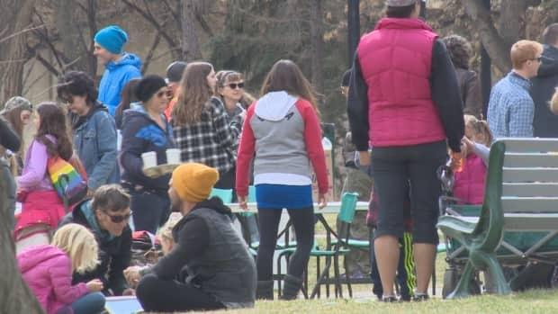 A large crowd attended a maskless children's festival at a downtown Saskatoon park in April 2021 in violation of public health laws which limit outdoor gatherings to 10 people.  (CBC - image credit)