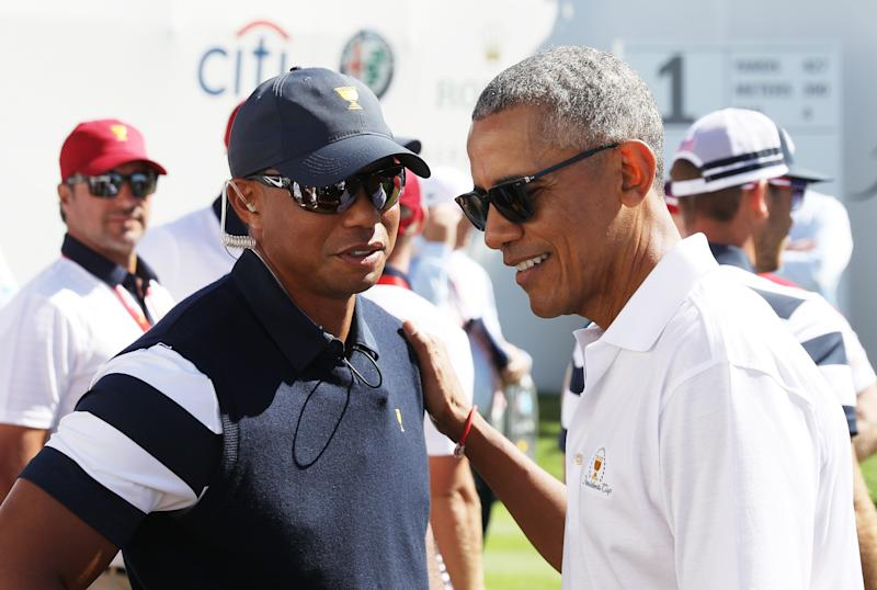 Tiger Woods, a captain's assistant for the U.S. team, talks with Obama. (Rob Carr via Getty Images)