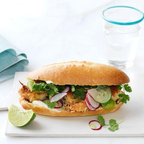 """<p>Coconut costed shrimp stars in this deliciously fun and fresh take on a Louisiana po' boy. </p><p><em><a href=""""https://www.womansday.com/food-recipes/food-drinks/recipes/a12526/crispy-coconut-shrimp-sandwich-recipe-wdy0714/"""" rel=""""nofollow noopener"""" target=""""_blank"""" data-ylk=""""slk:Get the recipe for Crispy Coconut Shrimp Sandwich"""" class=""""link rapid-noclick-resp"""">Get the recipe for Crispy Coconut Shrimp Sandwich</a></em></p>"""