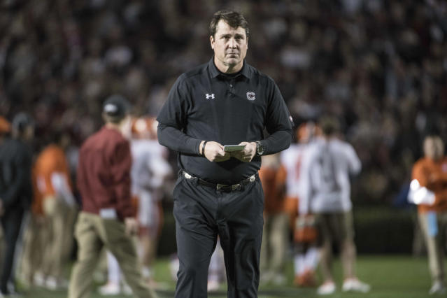 FILE – In this Nov. 25, 2017 file photo, South Carolina head coach Will Muschamp watches his players before an NCAA college football game against Clemson, in Columbia, S.C. (AP Photo/Sean Rayford, File)