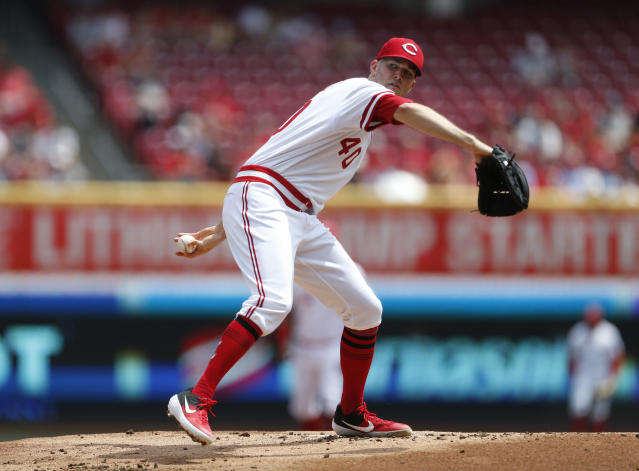 Cincinnati Reds starting pitcher Alex Wood (40) throws against the St. Louis Cardinals during the first inning of a baseball game, Sunday, Aug. 18, 2019, in Cincinnati. (AP Photo/Gary Landers)