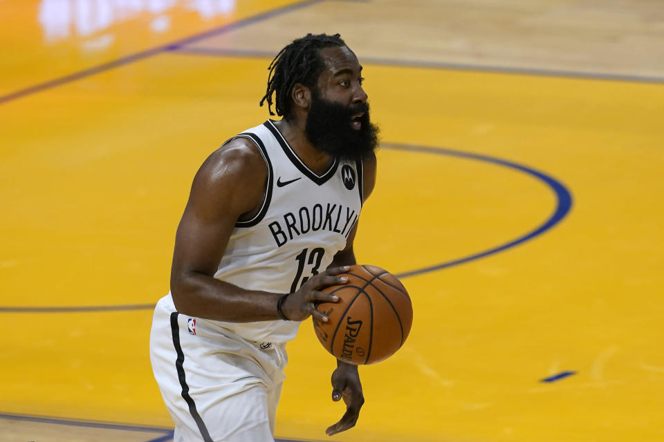 Brooklyn Nets guard James Harden brings the ball up during the first half of the team's NBA basketball game against the Golden State Warriors in San Francisco, Saturday, Feb. 13, 2021. (AP Photo/Jeff Chiu)