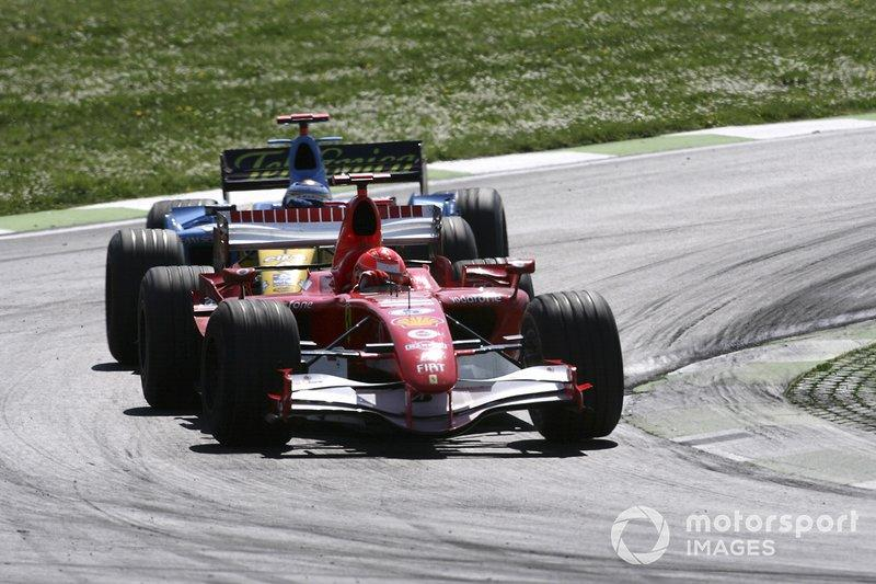 "Michael Schumacher, Ferrari 248F1, Fernando Alonso, Renault R26<span class=""copyright"">Charles Coates / Motorsport Images</span>"