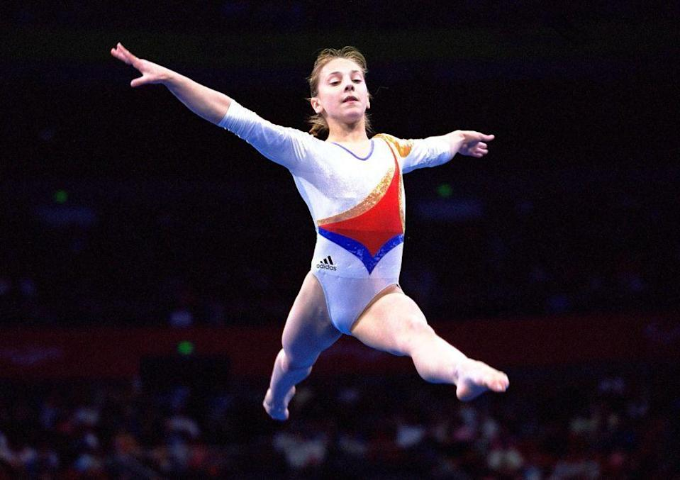 """<p>Romanian gymnast Andreea Răducan was stripped of her all-around gold medal when <a href=""""https://go.redirectingat.com?id=74968X1596630&url=https%3A%2F%2Fwww.espn.com%2Folympics%2Fgymnastics%2Fstory%2F_%2Fid%2F13153317%2Fandreea-raducan-asks-ioc-gold-medal-back-2000-olympics&sref=https%3A%2F%2Fwww.redbookmag.com%2Flife%2Fg36983465%2Ficonic-olympic-scandals%2F"""" rel=""""nofollow noopener"""" target=""""_blank"""" data-ylk=""""slk:she tested positive for pseudoephedrine, a banned stimulant found in a cold medicine"""" class=""""link rapid-noclick-resp"""">she tested positive for pseudoephedrine, a banned stimulant found in a cold medicine</a> she had taken. She approached the IOC 15 years later to try to have her medal reinstated, and though she received sympathy, was unsuccessful.</p>"""