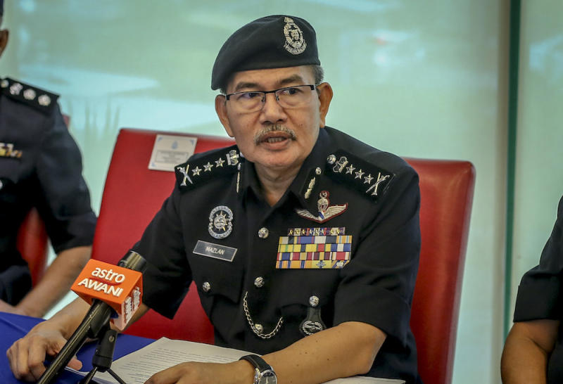 Kuala Lumpur police chief Comm Datuk Seri Mazlan Lazim said cops are on the hunt for two armed men following a shootout at a condominium in the city last night. — Picture by Firdaus Latif