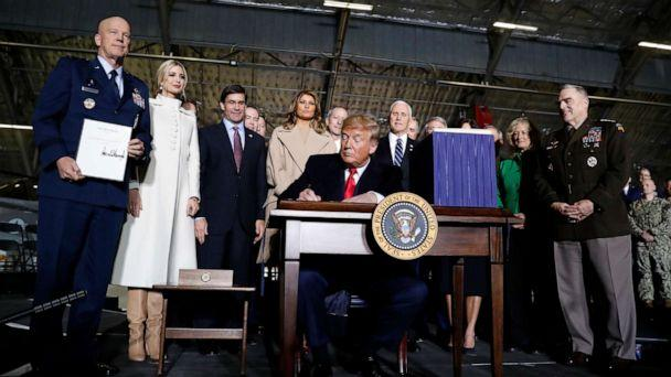 PHOTO: President Donald Trump signs the National Defense Authorization Act for Fiscal Year 2020 at Andrews Air Force Base, Md., Dec. 20, 2019. (Andrew Harnik/AP)