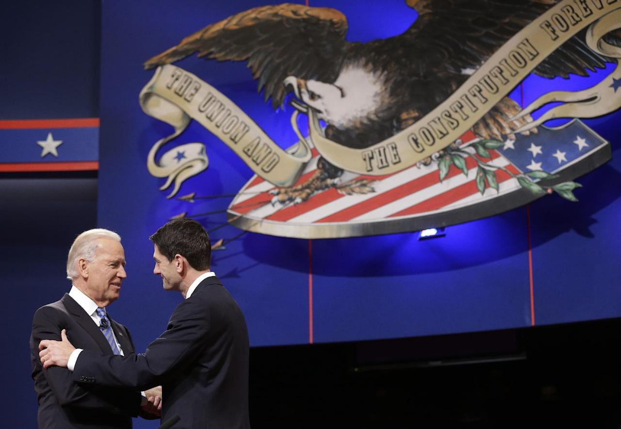 Vice President Joe Biden and Republican vice presidential candidate, Rep. Paul Ryan, R-Wis., shake hands before the start of the vice presidential debate, at Centre College in Danville, Ky., Thursday, Oct. 11, 2012. (AP Photo/Pablo Martinez Monsivais)
