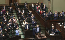 Poland's lawmakers after voting – some in parliament, some remotely – in Warsaw, Poland, on Tuesday, May 4, 2021. Polish lawmakers have voted to approve the nation's spending plan for the 58 billion euros ($70 billion) it expects to receive from the European Union's pandemic recovery plan. (AP Photo/Czarek Sokolowski)