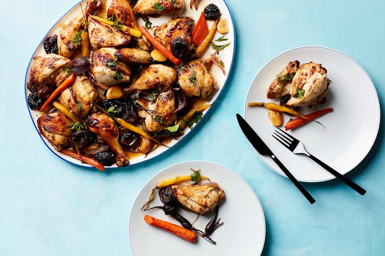 """This holiday-ready dinner has all the flavors of tzimmes, the traditional Jewish side dish made with stewed dried fruits and honey. Roasted on baking sheets with colorful young carrots, this recipe feeds a crowd with minimal effort. <a href=""""https://www.epicurious.com/recipes/food/views/tzimmes-chicken-with-apricots-prunes-and-carrots?mbid=synd_yahoo_rss"""">See recipe.</a>"""
