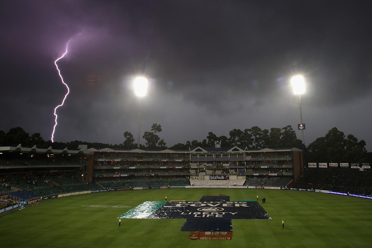 JOHANNESBURG, SOUTH AFRICA - FEBRUARY 28:  Lightning breaks over the ground as play is abandoned for the day due to rain and bad light during day three of the First Test between South Africa and Australia played at the Wanderers on February 28, 2009 in Johannesburg, South Africa.  (Photo by Hamish Blair/Getty Images)