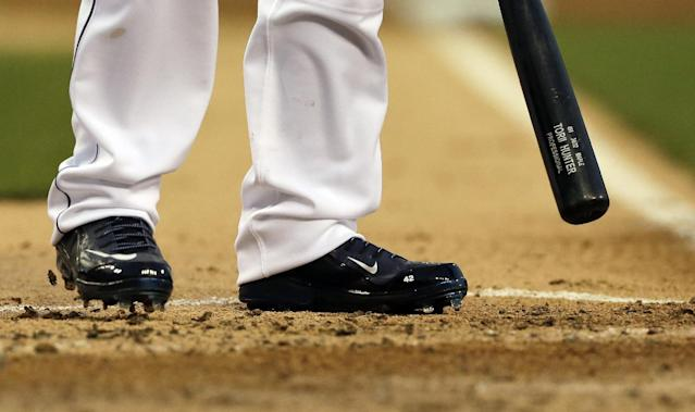 Detroit Tigers' Torii Hunter, wearing shoes with Jackie Robinson's number 42, stands in the batters box during the third inning of a baseball game against the Cleveland Indians in Detroit, Wednesday, April 16, 2014. (AP Photo/Carlos Osorio)