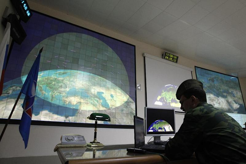 FILE - In this  Friday, May 4, 2012 file photo, a Russian military officer is on duty in the main control center of a radar station at the missile defense facility in Sofrino, 50 km (31 miles) northeast of Moscow. Secret U.S. Defense Department studies have cast doubt on whether a multibillion dollar missile defense system planned for Europe will ever be able to protect the United States from Iranian missiles as intended, congressional investigators say. (AP Photo/Mikhail Metzel, File)