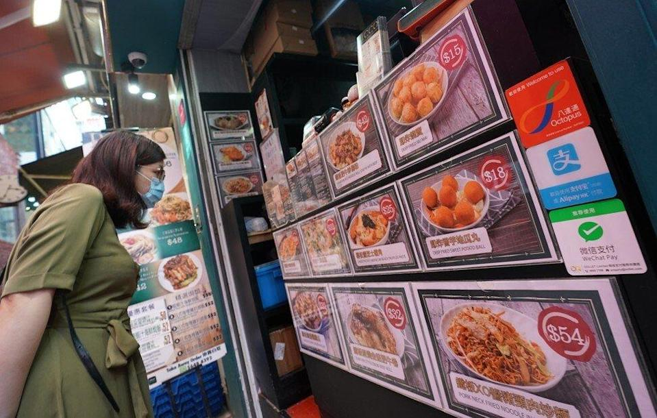 Hongkongers will be able to spend their vouchers at businesses such as restaurants and shops. Photo: Felix Wong
