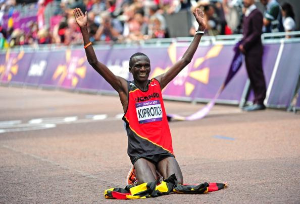 LONDON, ENGLAND - AUGUST 12:  Stephen Kiprotich of Uganda celebrates winning gold in the Men's Marathon on Day 16 of the London 2012 Olympic Games at The Mall on August 12, 2012 in London, England. (Photo by Stu Forster/Getty Images)