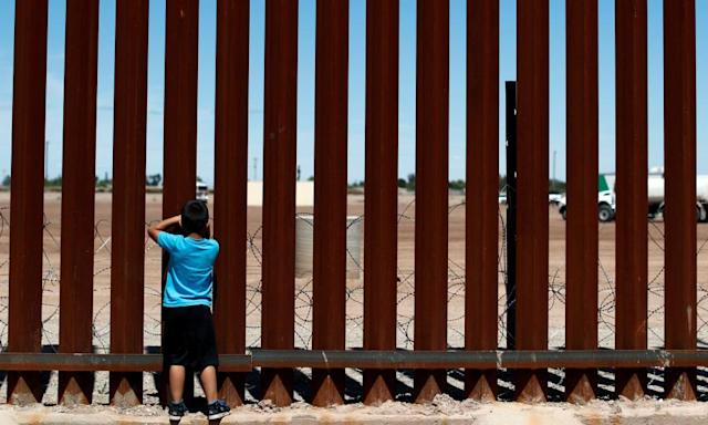 "<span class=""element-image__caption"">A child looks through the border wall between Calexico and Mexicali, where Andy Ruiz Jr fought at the start of his career.</span> <span class=""element-image__credit"">Photograph: Carlos Jasso/Reuters</span>"