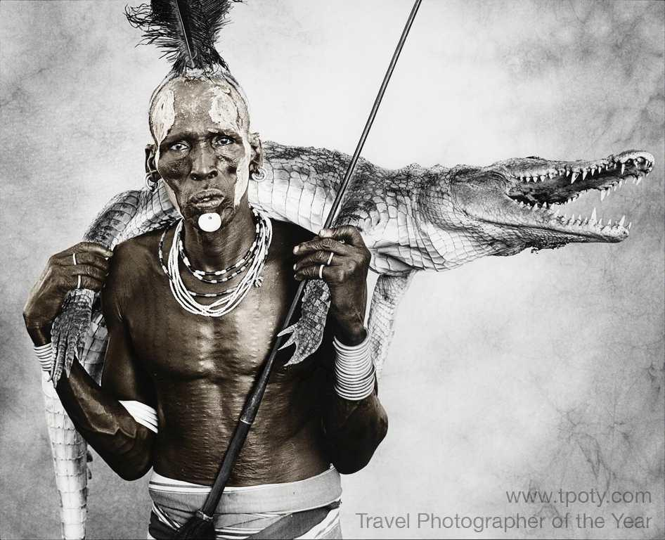 Kara tribe warrior, Omo River Valley, Ethiopia <br><br>Jan Schlegel, Germany <br><br>Camera: Ebony field SV45T1 4 x 5 inch camera <br><br>Runner-up, People Watching portfolio<br><br>The Runners-up in each portfolio category win a Digimarc for Images Professional subscription, a Plastic Sandwich leather portfolio or iFolio, and Adobe Photoshop Lightroom 4 software.