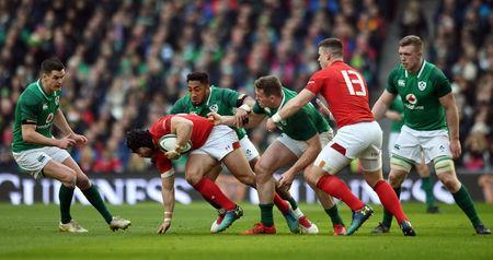 Rugby Union - Six Nations Championship - Ireland vs Wales - Aviva Stadium, Dublin, Republic of Ireland - February 24, 2018 Wales' Leigh Halfpenny in action with Ireland's Johnny Sexton, Bundee Aki and Chris Farrell REUTERS/Clodagh Kilcoyne