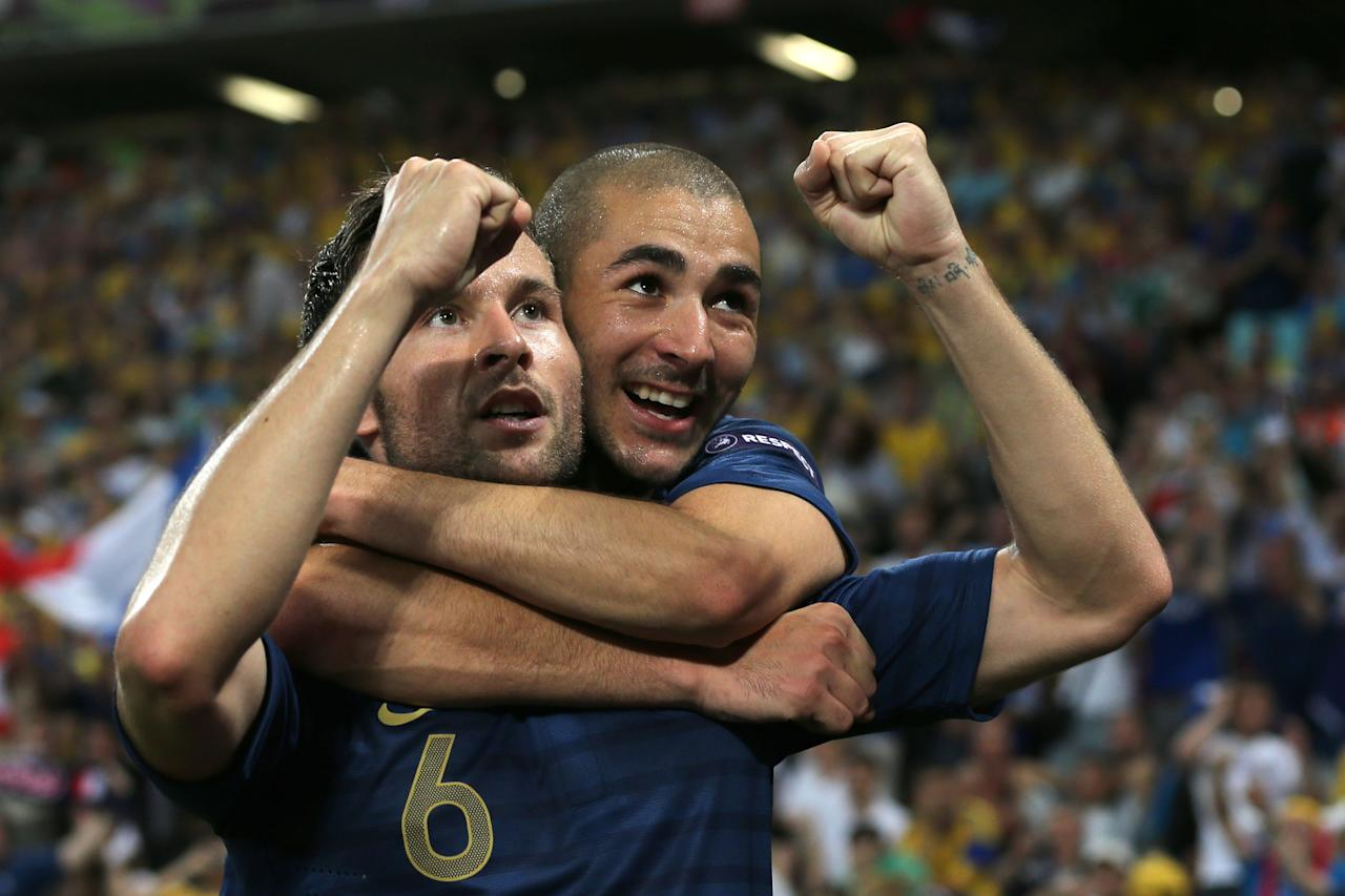 DONETSK, UKRAINE - JUNE 15:  Yohan Cabaye of France celebrates scoring their second goal with  Karim Benzema of France during the UEFA EURO 2012 group D match between Ukraine and France at Donbass Arena on June 15, 2012 in Donetsk, Ukraine.  (Photo by Ian Walton/Getty Images)