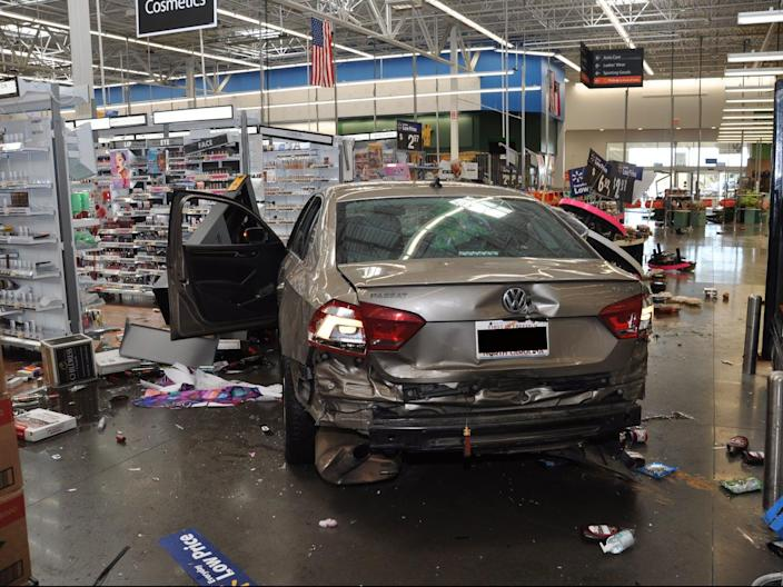 <p>Pictures released by Concord police show damage caused to a Walmart store on 2 April</p> (Concord Police Department)