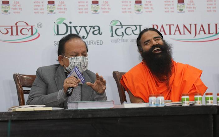 The Health Minister Harsh Vardhan and yogi Baba Ramdev -  RAJAT GUPTA/EPA-EFE/Shutterstock