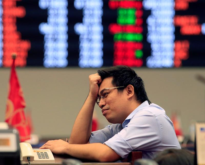 File Photo: A trader reacts during trading at the Philippine Stock Exchange in Makati city, Metro Manila, Philippines June 27, 2016. REUTERS/Romeo Ranoco