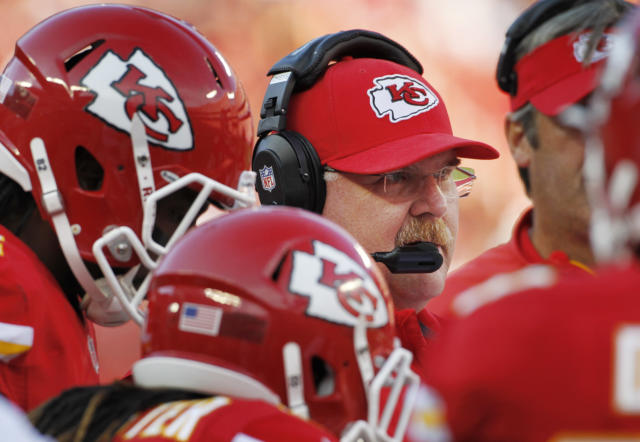 Kansas City Chiefs coach Andy Reid stands with his players during the first half of an NFL football game against the Houston Texans at Arrowhead Stadium in Kansas City, Mo., Sunday, Oct. 20, 2013. (AP Photo/Colin E. Braley)