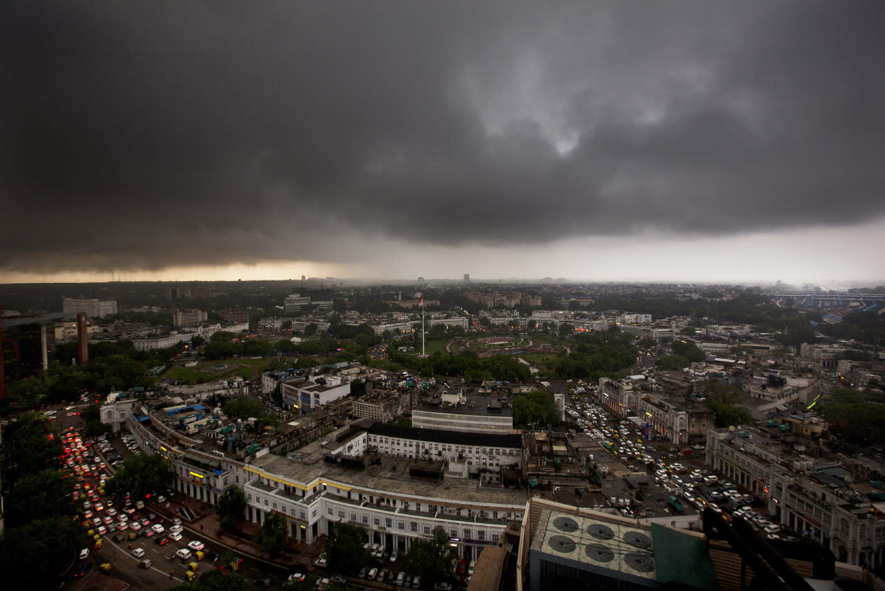<p>Monsoon clouds gather over the skyline in New Delhi, India, July 29, 2016. Monsoon season in India begins in June and ends in October. (Photo: Manish Swarup/AP)</p>