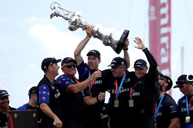 Sailing - America's Cup finals - Hamilton, Bermuda - June 26, 2017 - Peter Burling, Emirates Team New Zealand Helmsman holds the America's Cup with (from L) Kevin Shoebridge, Grant Dalton, Matteo de Nora and Glenn Ashby after defeating Oracle Team USA. REUTERS/Mike Segar