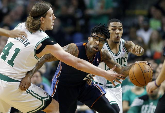 Boston Celtics' Kelly Olynyk (41) and Phil Pressey (26) battle Charlotte Bobcats' Chris Douglas-Roberts (55) for a loose ball in the third quarter of an NBA basketball game in Boston, Friday, April 11, 2014. The Celtics won 106-103. (AP Photo/Michael Dwyer)