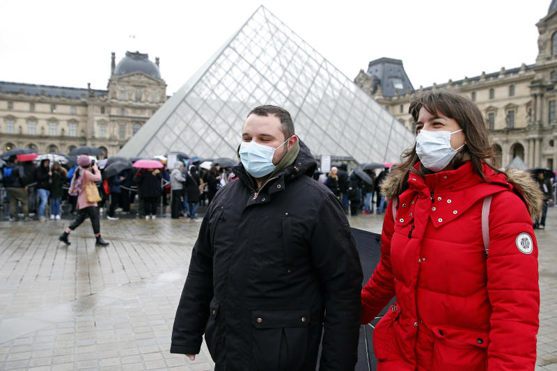 PARIS, FRANCE - MARCH 02: Tourists wearing protective masks walk past the Louvre Museum as the museum was closed for a staff meeting about the coronavirus outbreak on March 2, 2020 in Paris, France. Due to a sharp increase in the number of cases of coronavirus declared in Paris and throughout France, several sporting, cultural and festive events have been postponed or cancelled. The epidemic has exceeded 3,000 dead for more than 86,000 infections in 60 countries. In France, 130 cases are now confirmed, in 12 regions in total. (Photo by Chesnot/Getty Images)