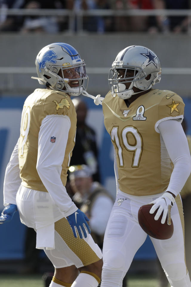 NFC wide receiver Amari Cooper, of the Dallas Cowboys (19), right, celebrates his touchdown with wide receiver Kenny Golladay, of the Detroit Lions (19), during the first half of the NFL Pro Bowl football game against the AFC, Sunday, Jan. 26, 2020, in Orlando, Fla. (AP Photo/Chris O'Meara)