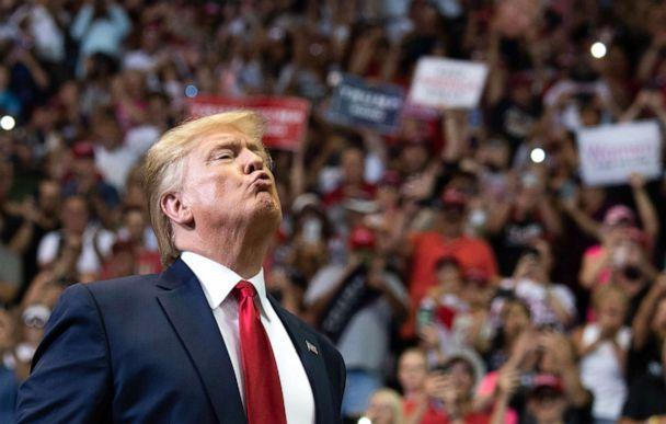 PHOTO: President Donald Trump gestures as he arrives to a 'Make America Great Again' campaign rally in Cincinnati, Aug. 1, 2019. (Saul Loeb/AFP/Getty Images)